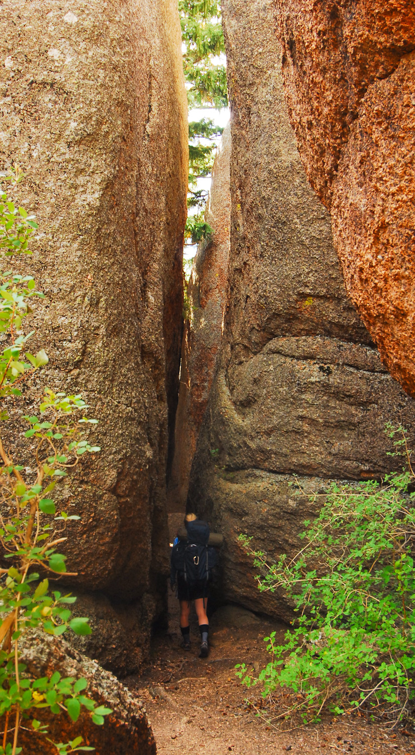 Tight passage between boulders at Lost Creek Wilderness