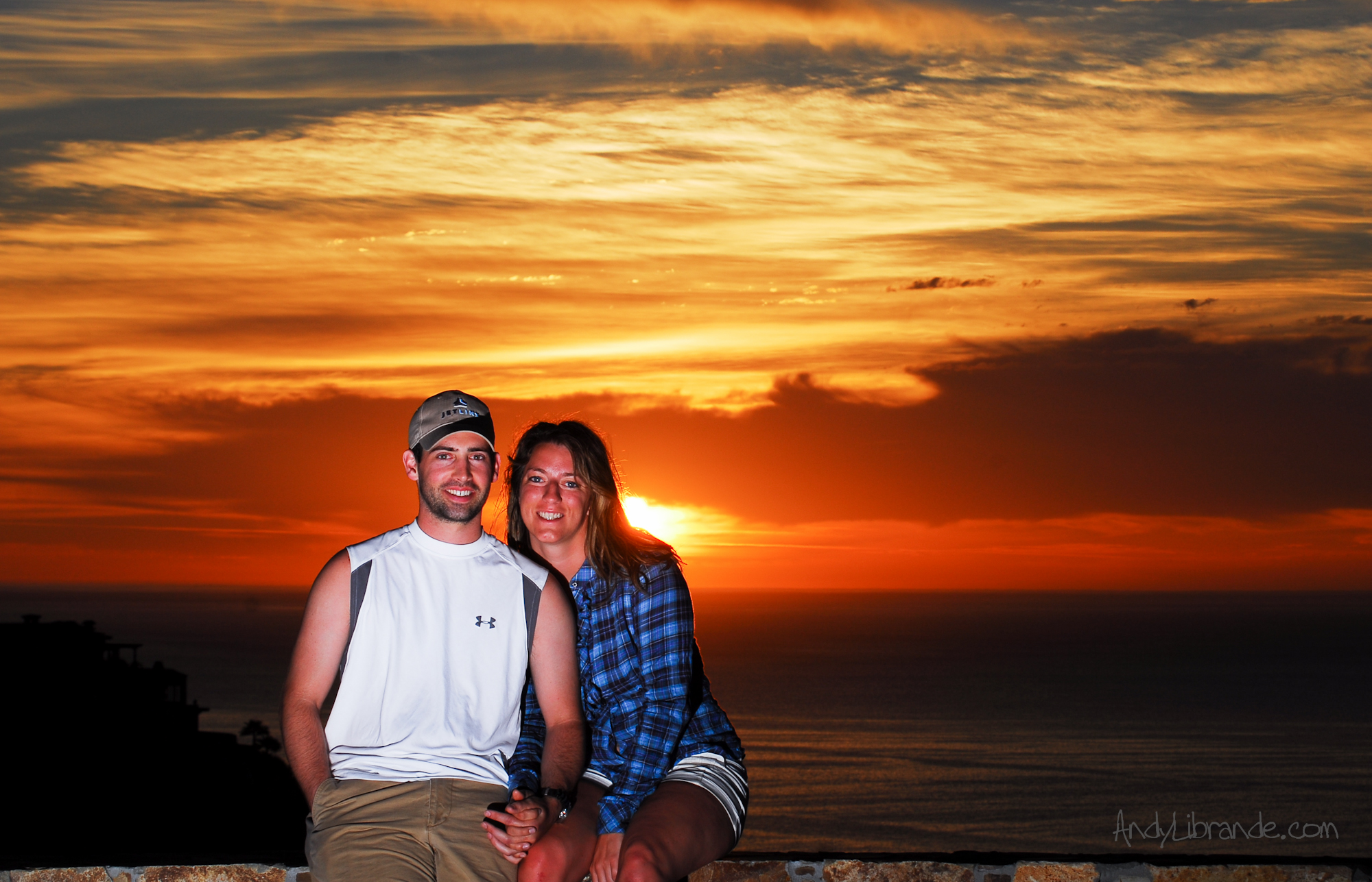 Whit and Andrew with a beautiful sunrise over Cabo San Lucas